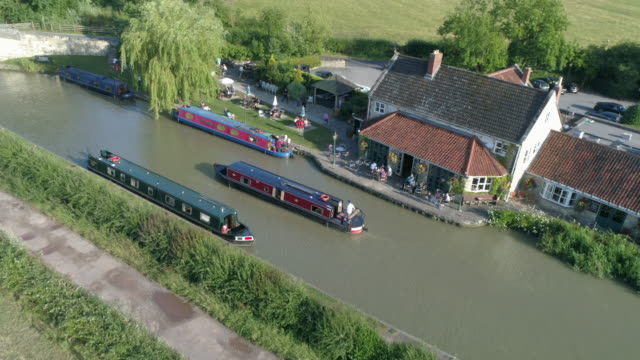 aerial drone view of boat in narrow canal - canal stock videos & royalty-free footage