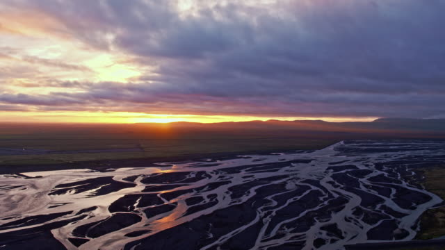 aerial drone view of braided river and midnight sun, iceland - dramatic landscape stock videos and b-roll footage