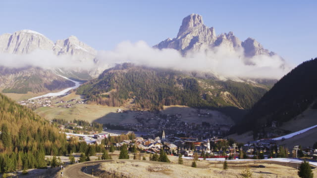 aerial drone view of corvara town in alta badia, dolomites, italy - town video stock e b–roll