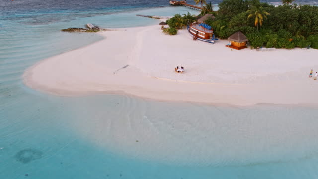 aerial drone view of couple eating on the beach, maldives - dining stock videos & royalty-free footage