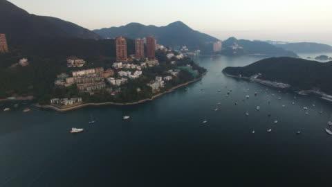 aerial drone view of deep water bay on hong kong island. - hong kong island stock videos & royalty-free footage
