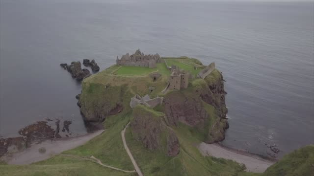 aerial drone view of dunnotar castle in a cloudy day - ruined stock videos & royalty-free footage