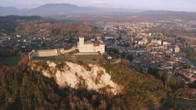 aerial drone view of famous fortress on lake maggiore, italy - castle stock videos & royalty-free footage