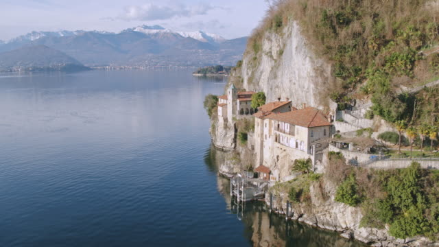 aerial drone view of famous hermitage on lake maggiore, italy - mediterranean culture stock videos & royalty-free footage