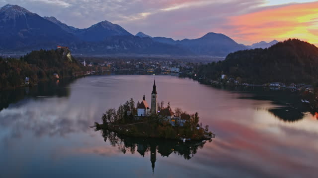 aerial drone view of famous lake bled at sunrise, slovenia - lake bled stock videos & royalty-free footage
