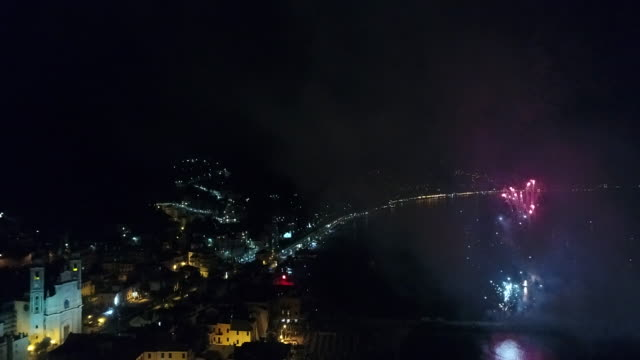 aerial drone view of fireworks over coastal town camogli and sea - italian culture stock videos & royalty-free footage