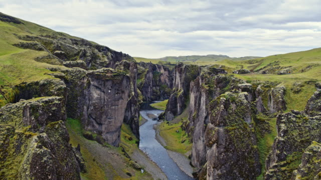aerial drone view of fjadrargljufur canyon, iceland - canyon stock videos & royalty-free footage