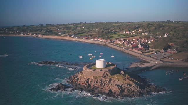 aerial drone view of fort grey, guernsey, channel islands, uk - 要塞点の映像素材/bロール