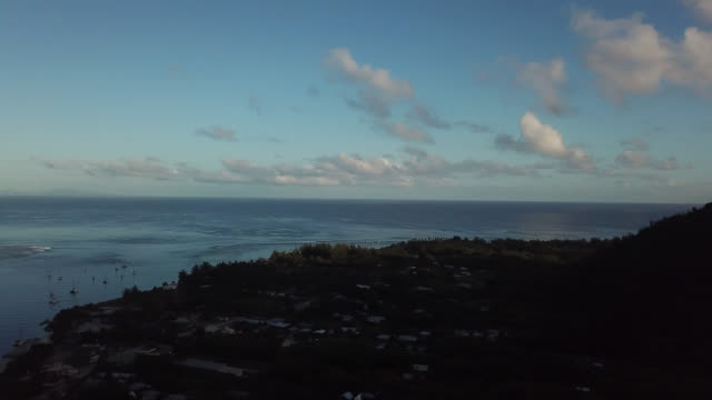 stockvideo's en b-roll-footage met aerial drone view of from the sea with the land in the foreground in the shade - huahine