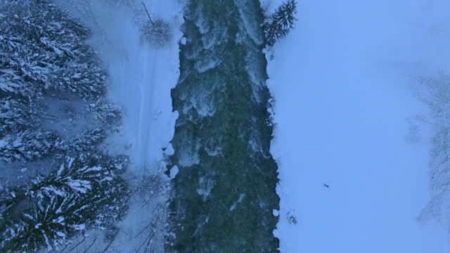 Aerial drone view of Gerlos, Austria and the Gerlosbach river in winter.