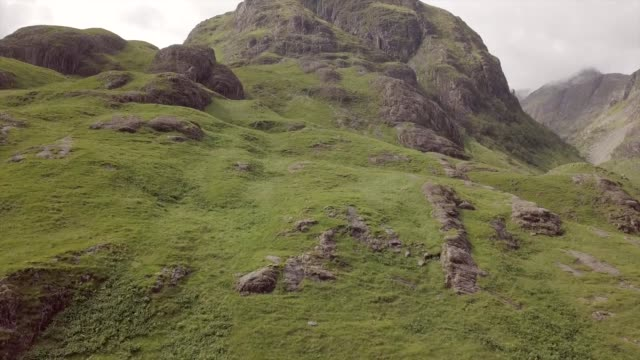 aerial drone view of glencoe in a cloudy day - hill stock videos & royalty-free footage