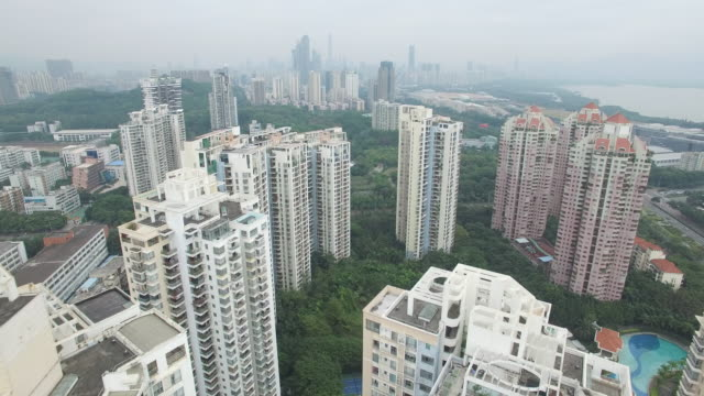 aerial drone view of high rise apartments near qiaocheng east in shenzhen china - china east asia stock videos & royalty-free footage