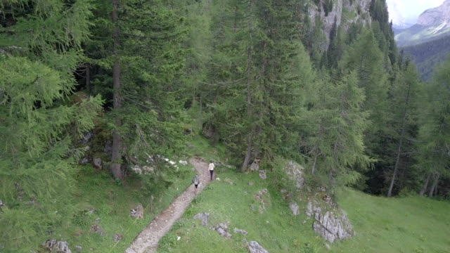 Aerial drone view of hikers hiking in the mountains.