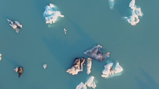 aerial drone view of icebergs, jokulsarlon, iceland - 30 seconds or greater stock videos & royalty-free footage