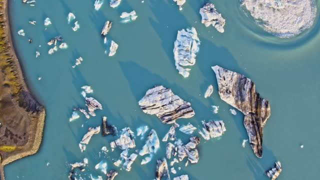 aerial drone view of icebergs, jokulsarlon, iceland - lagoon stock videos and b-roll footage