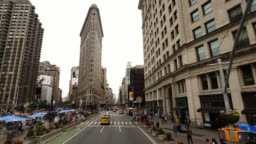 Aerial drone view of iconic Flatiron Building at Madison Square Park in New York City Manhattan NYC