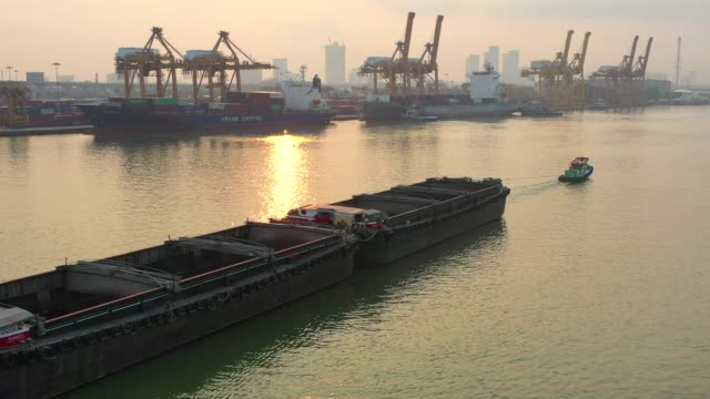 Aerial Drone View of Industrial port with Container port where is a part of shipping