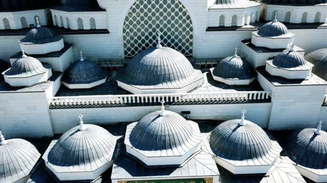 aerial drone view of istanbul camlica mosque and bosphorus. biggest mosque in europa - moschea video stock e b–roll