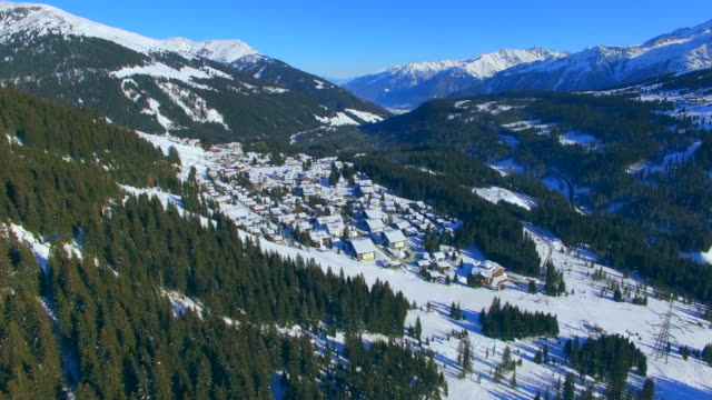 Aerial drone view of Konigsleiten, Austria snow mountains in winter at a ski resort.