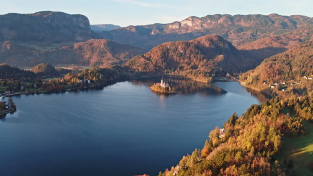 Aerial drone view of lake Bled in autumn and Bled Castle, Slovenia