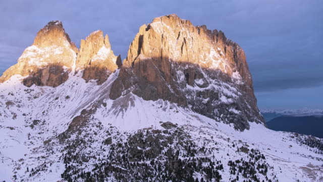Aerial drone view of majestic mountain peak at sunrise, Dolomites