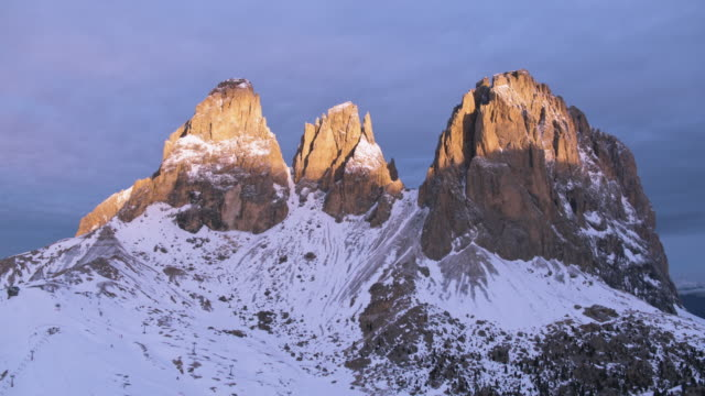aerial drone view of majestic mountain peak at sunrise, dolomites - val gardena video stock e b–roll
