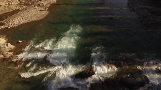 Aerial drone view of man fishing in river