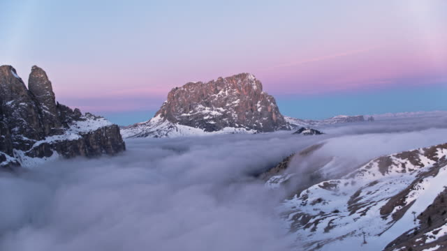 aerial drone view of mist filled valley and mountains at sunrise - langkofel sassolungo video stock e b–roll