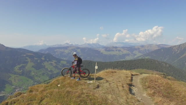 Aerial drone view of mountain biker biking in the mountains.