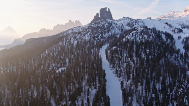 aerial drone view of mountain peak at sunrise, dolomites, italy - cortina stock videos & royalty-free footage