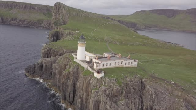 aerial drone view of neist point lighthouse at sunset - castle stock videos & royalty-free footage