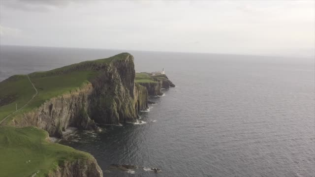aerial drone view of neist point lighthouse at sunset - hebrides stock videos & royalty-free footage