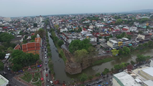 aerial drone view of people celebrating thai new year or songkran around the moat and city walls of chiang mai thailand new year is traditionally... - chiang mai city stock videos and b-roll footage