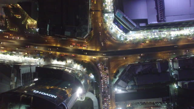 Aerial drone view of Pratunam intersection traffic in Bangkok Thailand