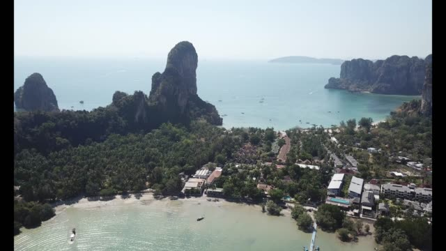 vidéos et rushes de aerial drone view of railay beach and surrounding areas in krabi - thaïlande