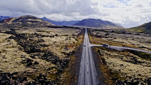 aerial drone view of road through lava fields, snaefellsnes, iceland - dramatic landscape stock videos and b-roll footage