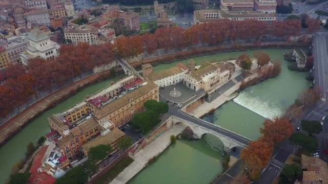 Aerial drone view of Rome, Italy, and Isola Tiberina island on the River Tiber.