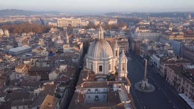 stockvideo's en b-roll-footage met aerial drone view of rome, italy, piazza navona square, and sant agnese in agone catholic church. - rome italië