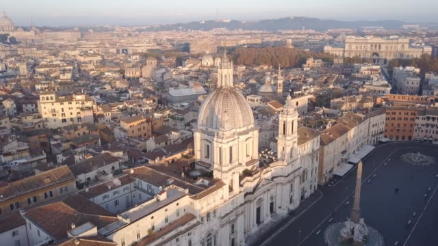 vidéos et rushes de aerial drone view of rome, italy, piazza navona square, and sant agnese in agone catholic church. - italie