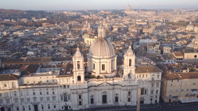 vidéos et rushes de aerial drone view of rome, italy, piazza navona square, and sant agnese in agone catholic church. - rome