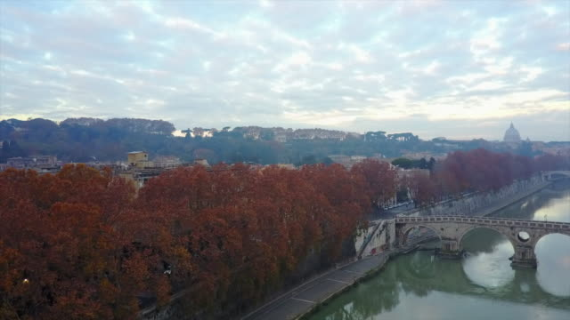 aerial drone view of rome, italy, river tiber and a bridge. - time-lapse - roma città video stock e b–roll