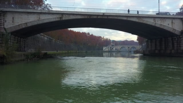 aerial drone view of rome, italy, river tiber and a bridge. - time-lapse - テベレ川点の映像素材/bロール