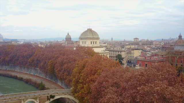 aerial drone view of rome, italy, river tiber and a bridge. - テベレ川点の映像素材/bロール