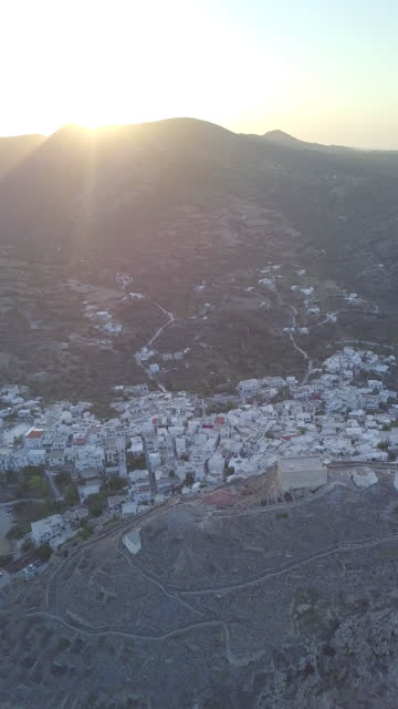 aerial drone view of rooftops in skyros, greece, vertical format. - vertical stock videos & royalty-free footage
