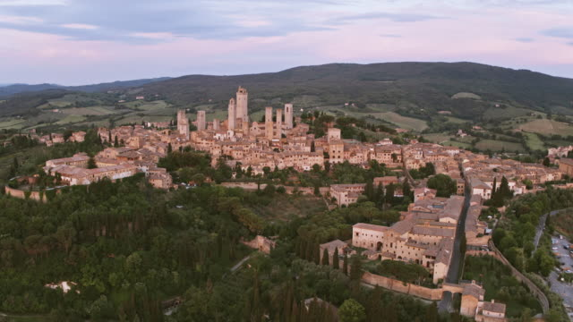 aerial drone view of san gimignano town, tuscany, italy - siena italy stock videos and b-roll footage