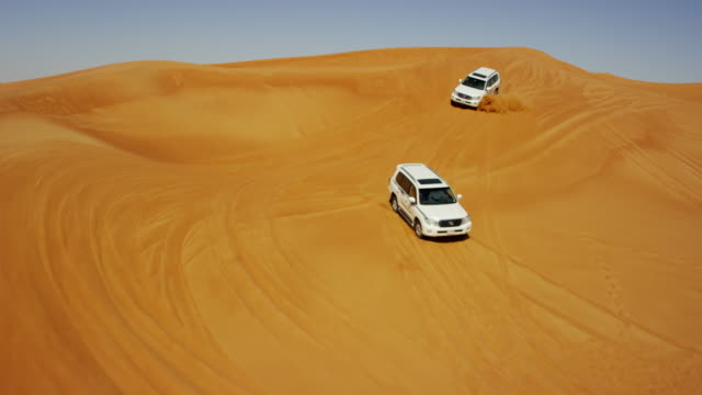 aerial drone view of sand dune trip dubai - sand dune stock videos & royalty-free footage
