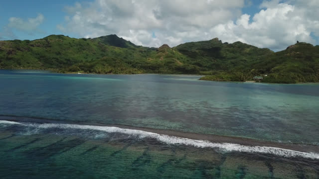 aerial drone view of scenic tropical islands and barrier reef in french polynesia. - huahine island stock videos and b-roll footage