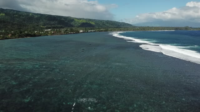 Aerial drone view of scenic tropical islands and barrier reef in French Polynesia.