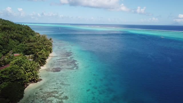 stockvideo's en b-roll-footage met aerial drone view of scenic tropical islands and sea in french polynesia. - huahine