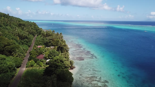aerial drone view of scenic tropical islands and sea in french polynesia. - huahine island stock videos and b-roll footage
